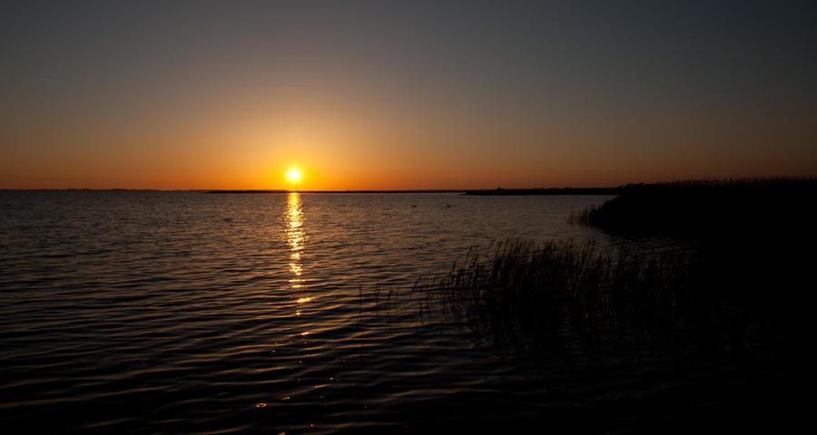Sonnenuntergang, Saaler Bodden, Ferienhäuser Boddenperlen